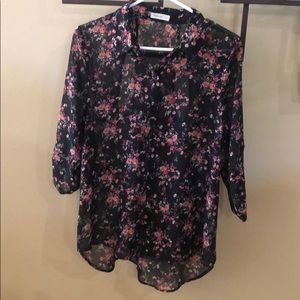 Floral blouse with racer back cut outs in back